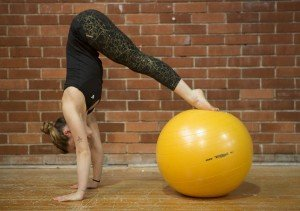 Gymnast Chiara Ferlito standing on a technogym's Arke ball while improving her static balance