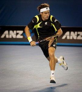 David Ferrer running to hit the ball