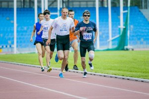 blind men athletes run 800 meters during Championship of Russia on track and field athletics among the blind
