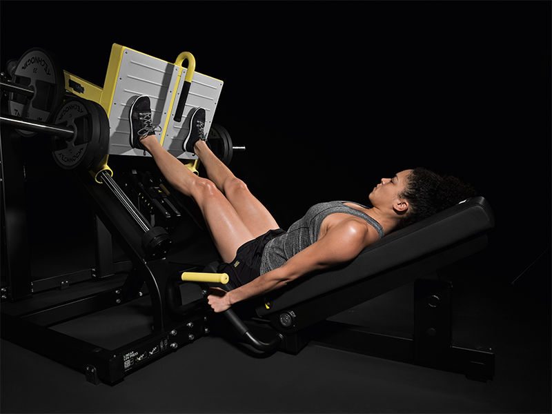 woman using leg press