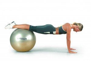 girl with streight leg on a wellness ball by technogym