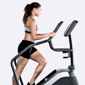 fitness model having a cardio workout on a technogym climb equipment