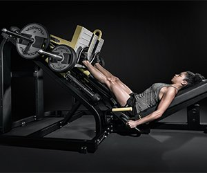 woman training with a pure strength weight machine