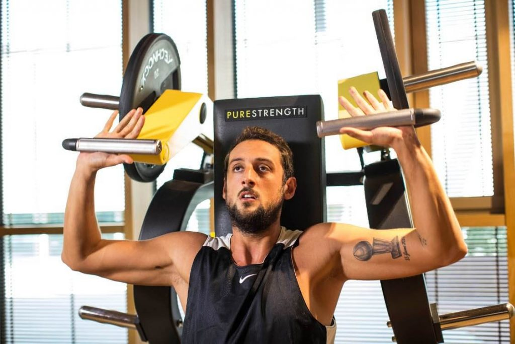 belinelli trains strength with technogym