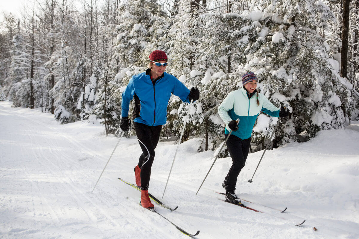 Couple practicing cross-country skiing